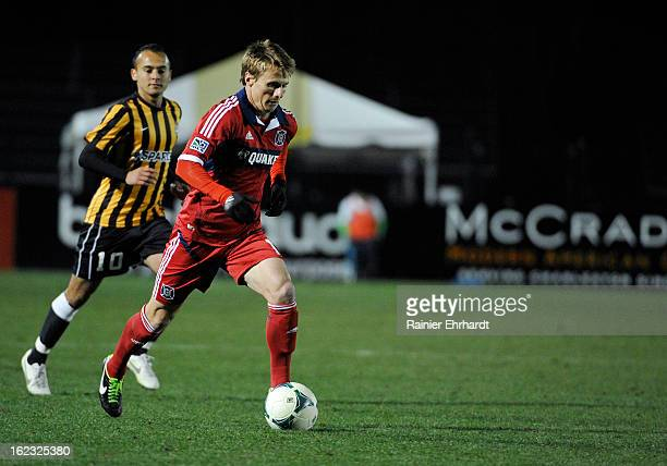Chris Rolfe of the Chicago Fire runs down field against the Charleston Battery during the first half of a game at Blackbaud Stadium on February 20...
