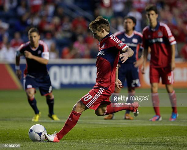 Chris Rolfe of the Chicago Fire scores a goal on the New England Revolution in the first half during their MLS match at Toyota Park on August 18 2012...