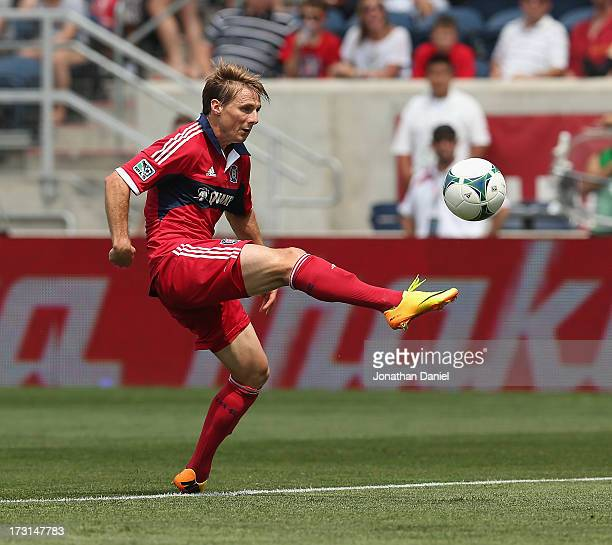Chris Rolfe of the Chicago Fire shoots the ball against Sporting Kansas City during an MLS match at Toyota Park on July 7 2013 in Bridgeview Illinois...