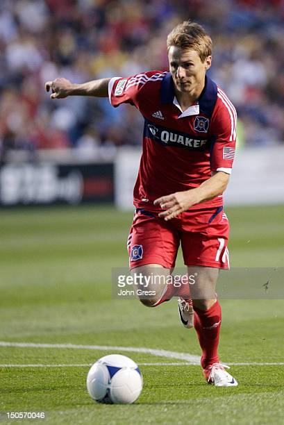 Chris Rolfe of the Chicago Fire takes on the New England Revolution in their MLS match at Toyota Park on August 18 2012 in Bridgeview Illinois The...