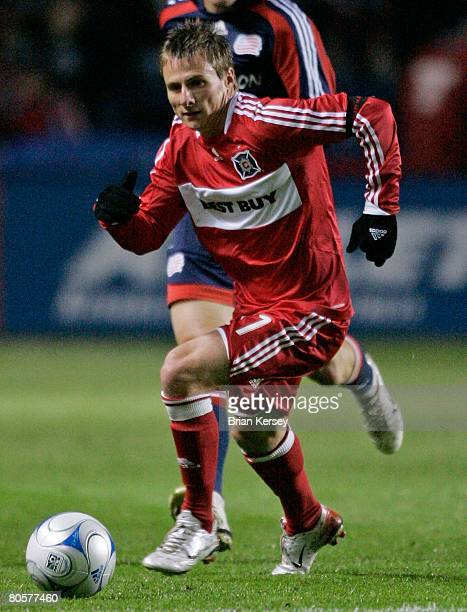 Chris Rolfe of the Chicago Fire takes the ball up the field during the first half against the New England Revolution at Toyota Park on April 3 2008...