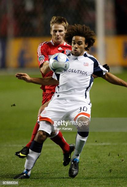 Chris Rolfe of the Chicago Fire tries toe get the ball away from Kevin Alston of the New England Revolution during the first half of Game Two of the...
