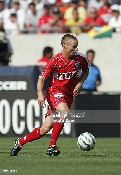 Chris Rolfe of the Columbus Crew moves the ball through midfield during the MLS game against the Chicago Fire on July 16 2005 at Soldier Field in...