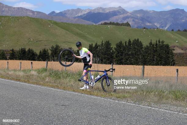 Chris Rush of Oamaru Adair Craik Accountants stops for a puncture repair during day three stage two from Riverton to Te Anau during the 2017 Tour of...
