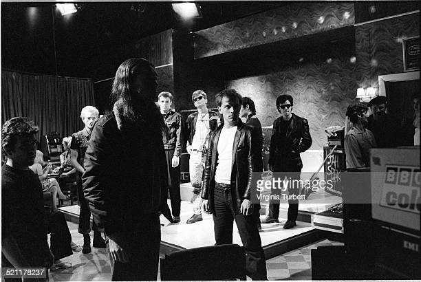 Chris Ryan as Mike Nigel Planer as Neil and Rik Mayall as Rick with members of the band Madness behind in front of a BBC camera on set during the...