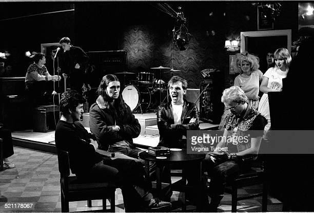 Chris Ryan as Mike Nigel Planer as Neil Rik Mayall as Rick and Adrian Edmondson as Vyvyan with members of the band Madness behind on set during the...