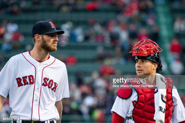 Chris Sale and Christian Vazquez of the Boston Red Sox walk toward the dugout before a game against the New York Yankees on April 10 2018 at Fenway...