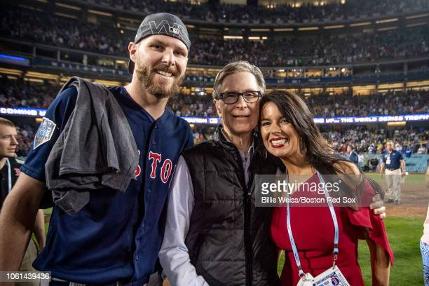 Chris Sale of the Boston Red Sox celebrates with Boston Red Sox Principal Owner John Henry and Linda Pizzuti Henry after winning the 2018 World...