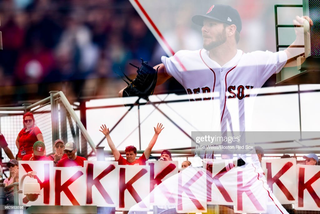 Chris Sale #41 of the Boston Red Sox delivers as fans hold K signs during the seventh inning of a game against the Seattle Mariners on June 24, 2018 at Fenway Park in Boston, Massachusetts.