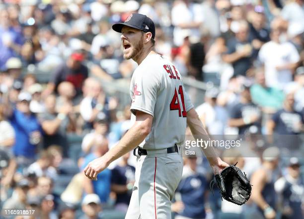 Chris Sale of the Boston Red Sox has words with home plate umpire Mike Estabrook as he leaves the game in the fourth inning against the New York...