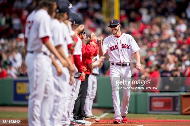 Chris Sale of the Boston Red Sox high fives teammates as he is introduced before the home opener against the Pittsburgh Pirates April 3 2017 at...