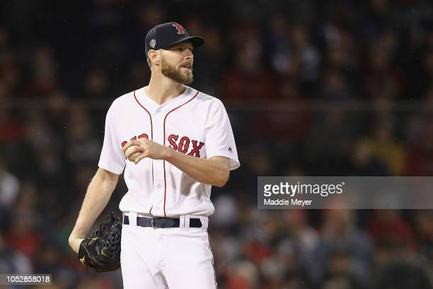 Chris Sale of the Boston Red Sox reacts after allowing a base hit during the fifth inning against the Los Angeles Dodgers in Game One of the 2018...
