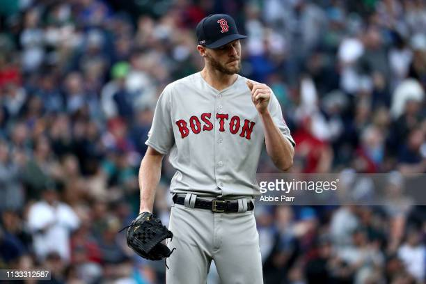 Chris Sale of the Boston Red Sox reacts after giving up a solo home run to Edwin Encarnacion of the Seattle Mariners in the third inning during their...