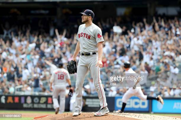 Chris Sale of the Boston Red Sox reacts as DJ LeMahieu of the New York Yankees rounds first after he hit a solo home run in the first inning during...