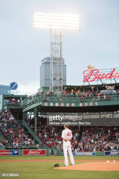 Chris Sale of the Boston Red Sox stands for the national anthem before the start of a game against the New York Yankees at Fenway Park on April 27...
