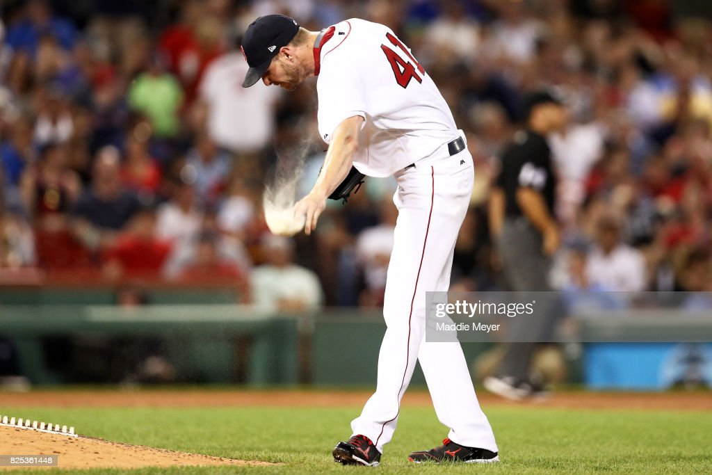 Chris Sale #41 of the Boston Red Sox throws his rosin bag after Edwin Encarnacion #10 of the Cleveland Indians hit a two run homer during the fifth inning at Fenway Park on August 1, 2017 in Boston, Massachusetts.