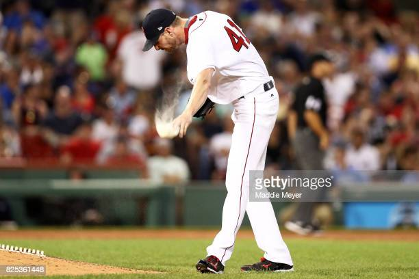 Chris Sale of the Boston Red Sox throws his rosin bag after Edwin Encarnacion of the Cleveland Indians hit a two run homer during the fifth inning at...