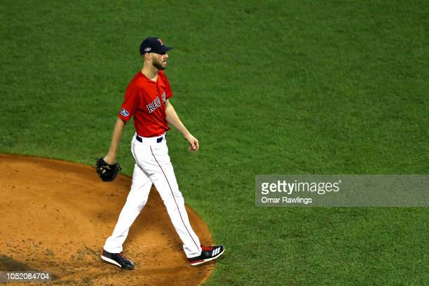 Chris Sale of the Boston Red Sox walks off the field after the top of the fourth inning against the Houston Astros in Game One of the American League...