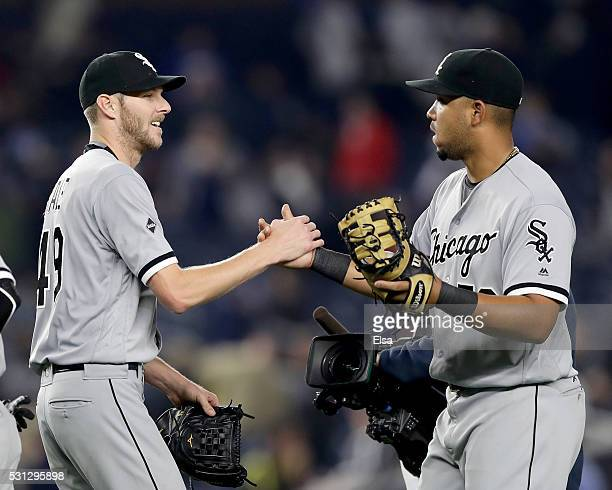 Chris Sale of the Chicago White Sox is congratulated by teammate Jose Abreu after the game against the New York Yankees at Yankee Stadium on May 13...