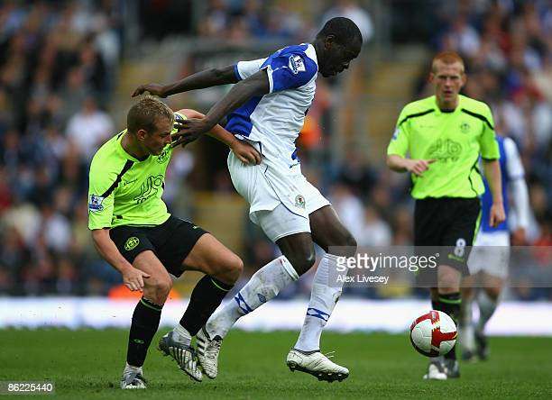 Chris Samba of Blackburn Rovers holds off the challenge of Lee Cattermole of Wigan Athletic during the Barclays Premier League match between...