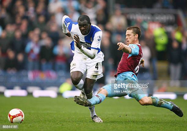 Chris Samba of Blackburn Rovers is tackled by Scott Parker of West Ham United during the Barclays Premier League match between Blackburn Rovers and...