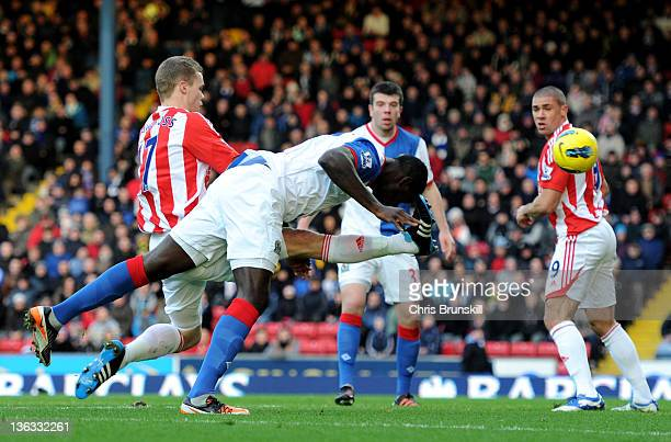 Chris Samba of Blackburn Rovers scores a disallowed goal under pressure from Ryan Shawcross of Stoke City during the Barclays Premier League match...