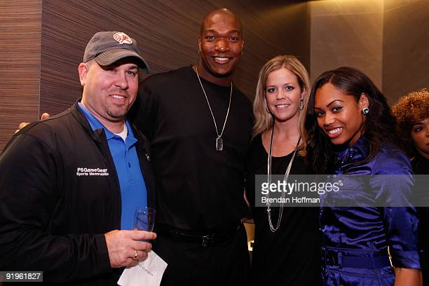 Chris Samuels poses with guests at a cocktail party hosted by David Yurman to benefit the Chris Samuels Foundation on October 16, 2009 in McLean, VA.