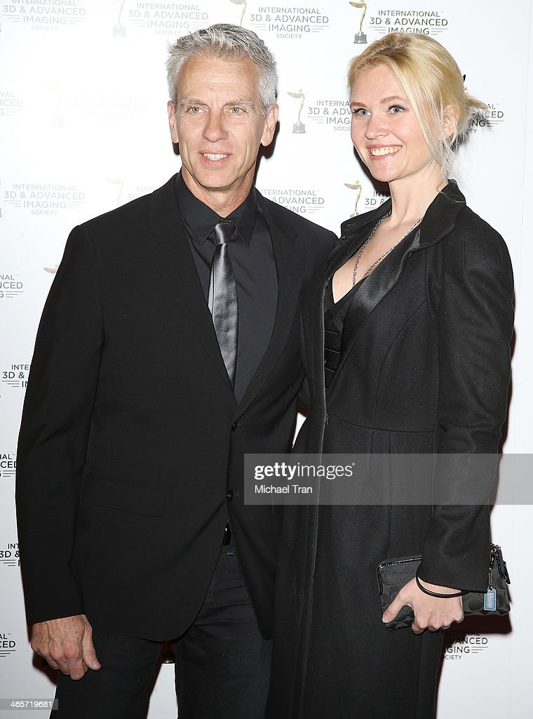 Chris Sanders (L) and guest arrive at the 2014 International 3D and Advanced Imaging Society's Creative Arts Awards held at Steven J. Ross Theatre on January 28, 2014 in Burbank, California.