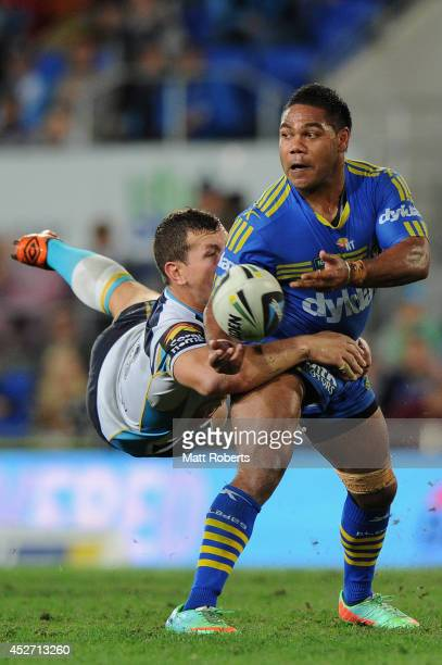 Chris Sandow of the Eels is tackled by Greg Bird of the Titans during the round 20 NRL match between the Gold Coast Titans and the Parramatta Eels at...