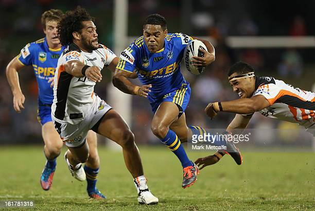 Chris Sandow of the Eels makes a break during the NRL trial match between the Wests Tigers and the Parramatta Eels at Campbelltown Sports Stadium on...