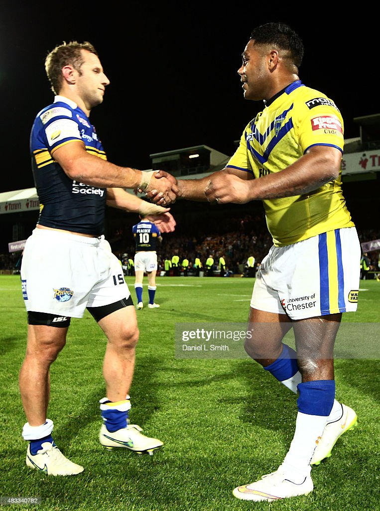 Chris Sandow of Warrington Wolves congratulates Rob Burrow of Leeds Rhinos after the Round 1 match of the First Utility Super League Super 8s between Leeds Rhinos and Warrington Wolves at Headingley Carnegie Stadium on August 7, 2015 in Leeds, England.