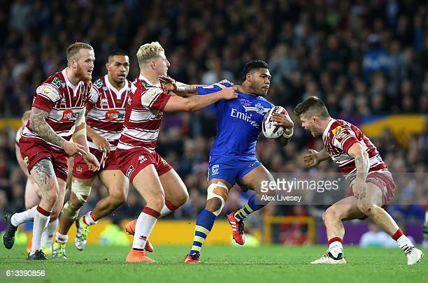 Chris Sandow of Warrington Wolves is tackled by George Williams of Wigan Warriors during the First Utility Super League Final between Warrington...