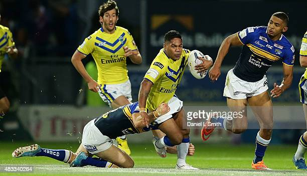 Chris Sandow of Warrington Wolves is tackled during the Round 1 match of the First Utility Super League Super 8s between Leeds Rhinos and Warrington...