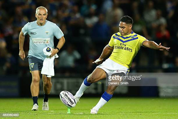 Chris Sandow of Warrington Wolves kicks the ball into play in the second half of the Round 1 match of the First Utility Super League Super 8s between...