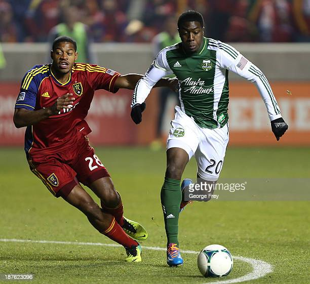 Chris Schuler of Real Salt Lake and Jose Adolfo Valencia of the Portland Timbers chase down a ball during the second half of the Western Conference...