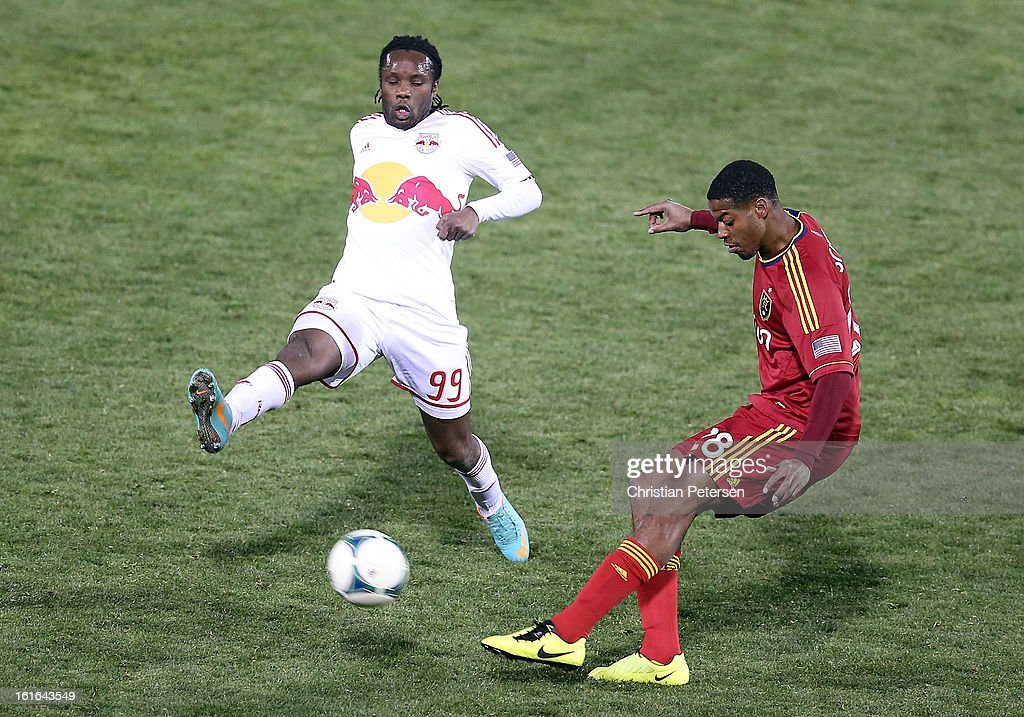 Chris Schuler #28 of Real Salt Lake shoots the ball past Peguy Luyindula #99 of the New York Red Bulls during the second half of the FC Tucson Desert Diamond Cup at Kino Sports Complex on February 13, 2013 in Tucson, Arizona.
