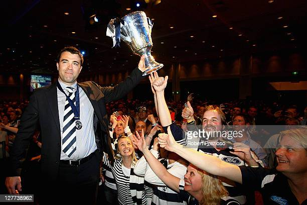 Chris Scott holds the premiership cup with fans during Geelong Cats AFL Grand Final celebrations at Melbourne Park on October 1 2011 in Melbourne...