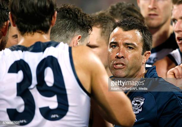 Chris Scott Senior Coach of the Cats addresses his players during the 2016 AFL Round 06 match between the Geelong Cats and the Gold Coast Suns at...