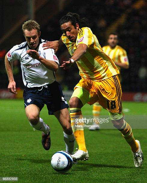 Chris Sedgwick of Preston battles with Jonas Gutierrez of Newcastle United during the CocaCola Championship match between Preston North End and...