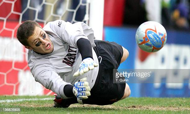Chris Seitz of Maryland stuffs Ossie Michalsen's penalty kick to help Maryland to a penalty kick over time victory Maryland survived Akron after...