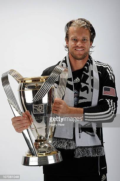 Chris Sharpe of the Colorado Rapids poses with the Philip F Anschutz MLS Cup trophy following the MLS Cup final at BMO Field on November 21 2010 in...