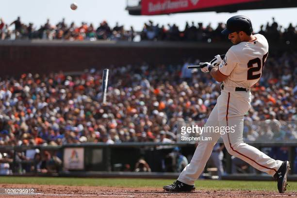 Chris Shaw of the San Francisco Giants breaks his bat while hitting a fly out against the New York Mets during the fifth inning of their MLB baseball...