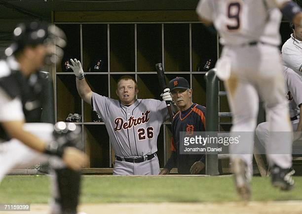 Chris Shelton of the Detroit Tigers celebrates in the dugout as manager Jim Leyland of the Tigers watches Carlos Guillen score a run in the 6th...