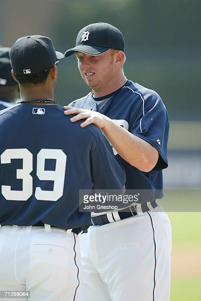 Chris Shelton of the Detroit Tigers chats with teammate Ramon Santiago prior to the game against the New York Yankees at Comerica Park in Detroit...