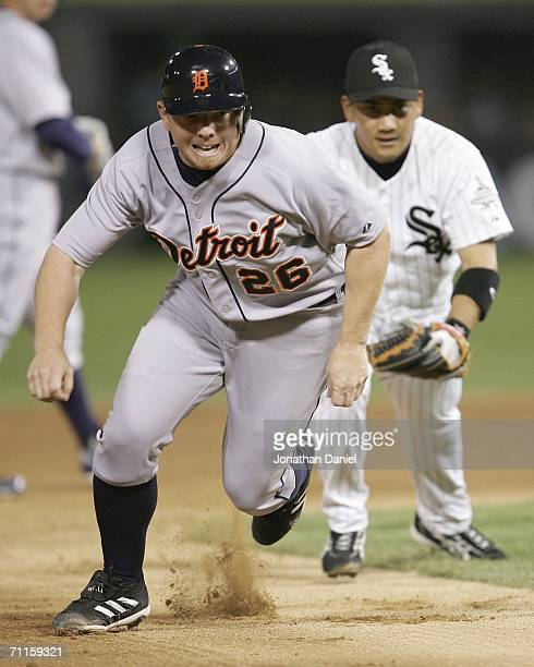 Chris Shelton of the Detroit Tigers gets caught in a rundown as second baseman Tadahito Iguchi of the Chicago White Sox chases him on June 8 2006 at...
