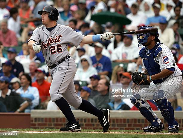 Chris Shelton of the Detroit Tigers hits a tworun home run in the first inning against Mark Prior of the Chicago Cubs as catcher Henry Blanco watches...
