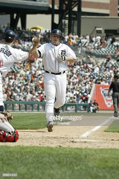 Chris Shelton of the Detroit Tigers is greeted by the batboy during the game against the Boston Red Sox at Comerica Park on August 17 2005 in Detroit...