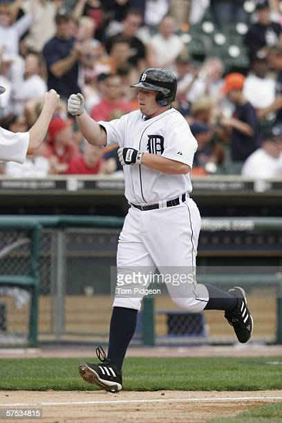 Chris Shelton of the Detroit Tigers receives congratulations after hitting a home run against the Chicago White Sox at Comerica Park on April 13 2006...