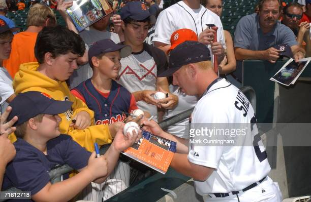 Chris Shelton of the Detroit Tigers signs autographs prior to the game against the Oakland Athletics at Comerica Park in Detroit Michigan on July 23...