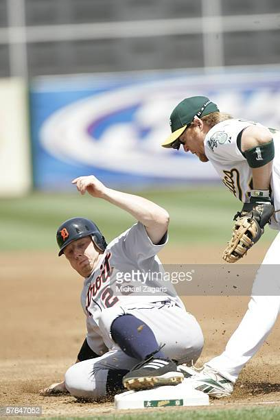 Chris Shelton of the Detroit Tigers slides into first base during the game against the Oakland Athletics at the Network Associates Coliseum in...